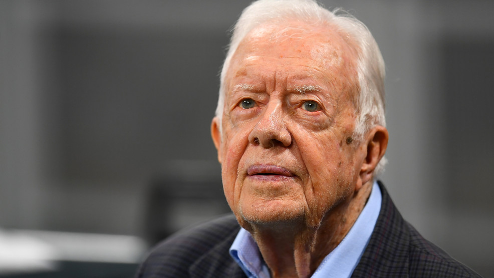 FILE- Former president Jimmy Carter prior to the game between the Atlanta Falcons and the Cincinnati Bengals at Mercedes-Benz Stadium on September 30, 2018 in Atlanta, Georgia. (Photo by Scott Cunningham/Getty Images)